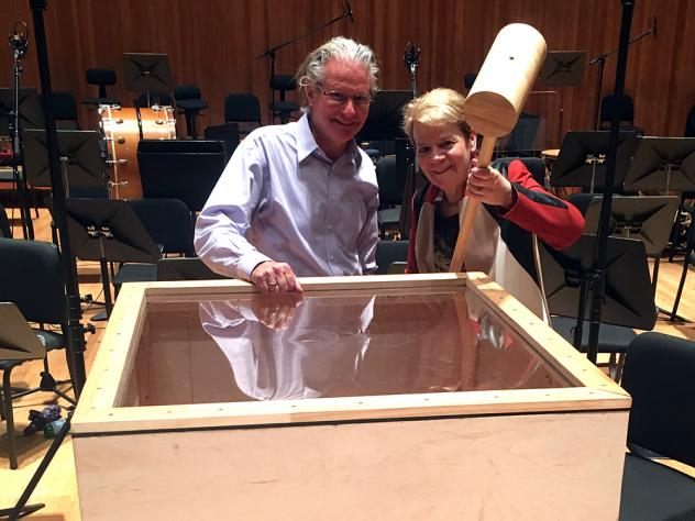 Baltimore Symphony Orchestra percussionist John Locke stands beside conductor Marin Alsop, who holds the giant hammer Gustav Mahler includes in his Sixth Symphony.
