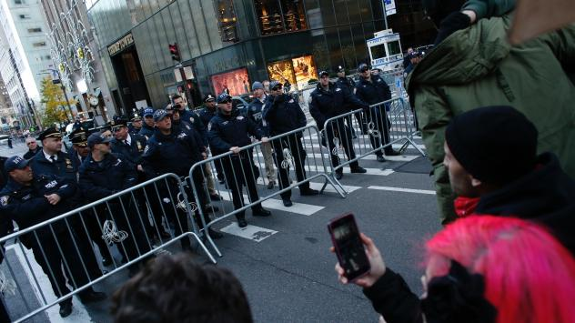 New York police officers block the street during a protest against U.S. President-elect Donald Trump in front of Trump Tower on Nov. 12, 2016 in New York. Americans spilled into the streets Saturday for a new day of protests against Trump, even as he app