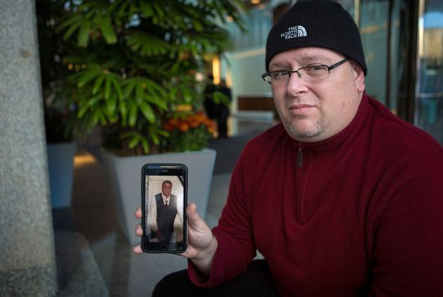 Anthony Salemi, of Everett, Mass., holds a photo of his brother Joe, who died from and overdose of fentanyl-laced heroin earlier this year.