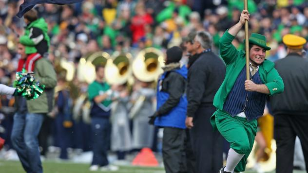 The Notre Dame Leprechaun mascot runs onto the field before a 2013 game between the Fighting Irish and the Navy Midshipmen at Notre Dame Stadium in South Bend, Indiana. Notre Dame defeated Navy 38-34. The school has been ordered to vacate all its victori