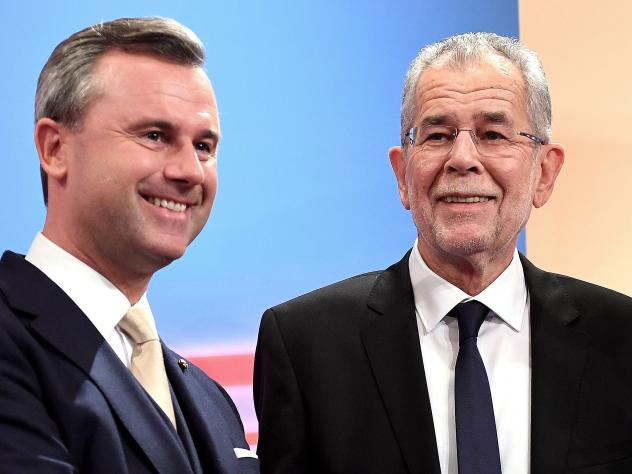 Austrian far-right candidate Norbert Hofer (L) and his rival Alexander Van der Bellen attend a post-selection TV talk with in Vienna on Dec. 4, 2016. Austrian far-right candidate Norbert Hofer on Sunday congratulated his opponent in presidential election