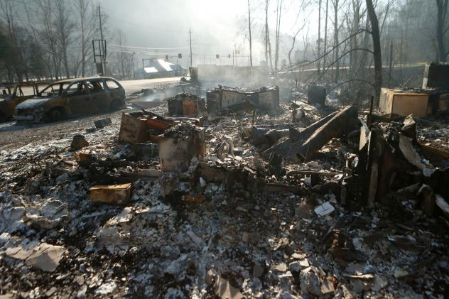 Tammy Sherrod and her husband, Scott, examine the remains of their home in the Roaring Fork neighborhood of Gatlinburg, Tenn., on Friday. Residents were getting their first look at what remains of their homes and businesses after a wildfire tore through