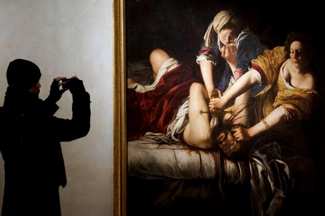"""In <em>Judith and her Maidservant, </em>painted a year after Gentileschi testified in a rape trial, the head of Holofernes lies in a basket and Judith is portrayed proudly as victor. """"That is not a characteristic Judith pose,"""" says a curator of the Rome"""