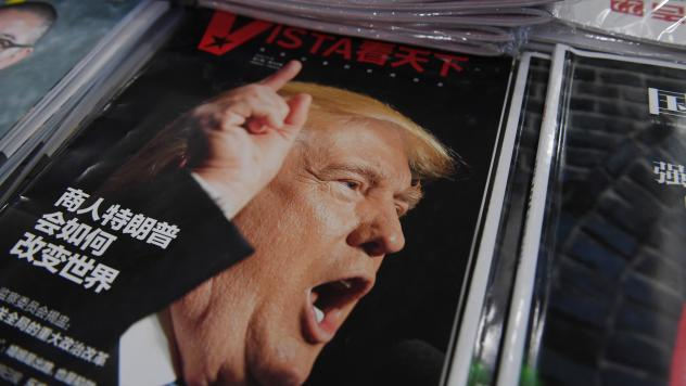 """A magazine featuring U.S. President-elect Donald Trump is seen at a bookstore in Beijing on Monday. The headline reads, """"How will businessman Trump change the world?"""" Beijing is """"seriously concerned"""" by Trump's suggestion that he could drop Washington's"""