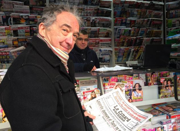 A book that celebrates 100 years of the weekly <em>Le Canard Enchaine.</em>