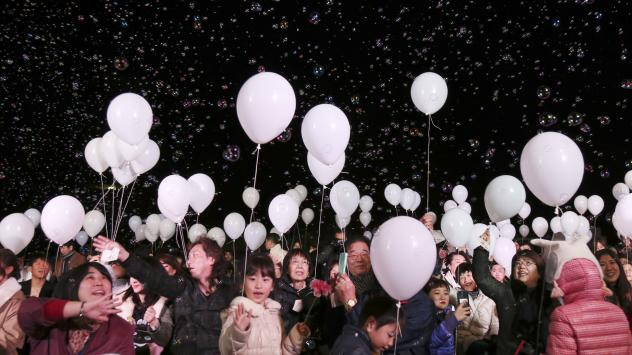 Bubbles float over visitors during a New Year's Eve celebration event a Tokyo hotel. Japanese Prime Minister Shinzo Abe gave a speech at Pearl Harbor about the power of reconciliation in the waning days of 2016.