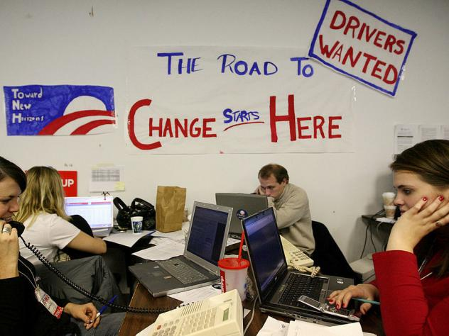 "Volunteers in Des Moines make calls at the campaign headquarters of then-Democratic presidential hopeful Sen. Barack Obama on Dec. 5, 2007 ahead of the Iowa caucus. Obama has called those ""fired-up"" campaign workers from his 2008 campaign, one of his pro"