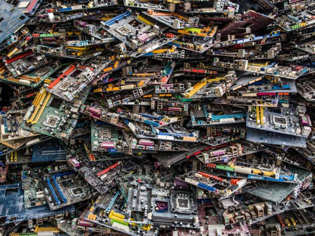 """At a """"backyard"""" recycling operation just outside of Jakarta, men place circuit boards in an oven and fire them to smelt out gold and other precious metals."""