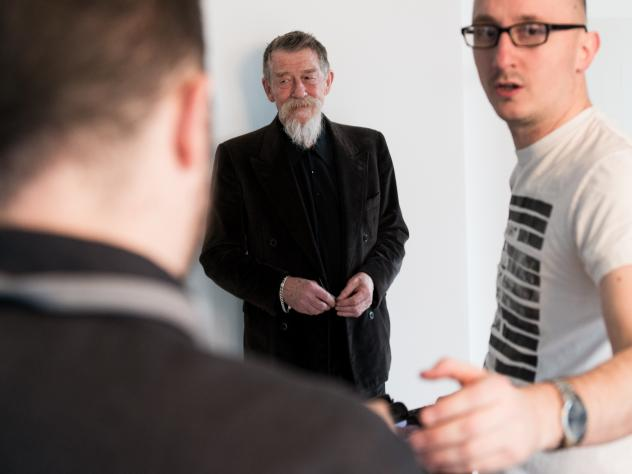 John Hurt waits for his photo to be taken in 2014 during a publicity tour for <em>Snowpiercer</em>. The British actor's death was confirmed Friday by his publicist.