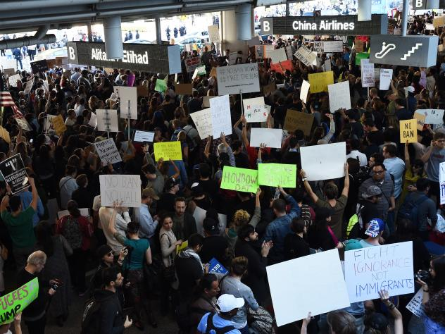 Protesters rally against President Trump's executive order halting U.S. entry of refugees and others, Sunday at Los Angeles International Airport.