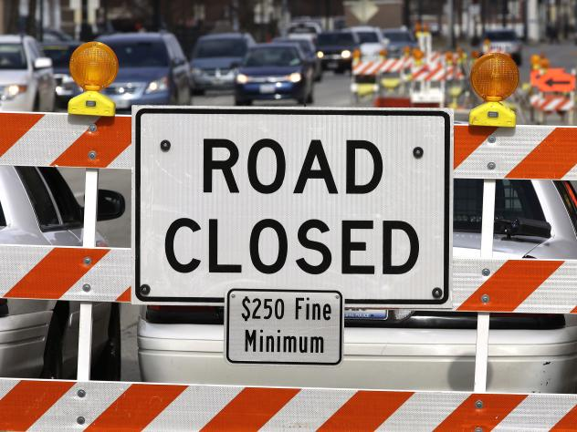 A road repair blocks traffic in Springfield, Ill. as Congress tries to decide how to pay for President Trump's ambitious spending plan to rebuild roads, bridges, railroads and airports.