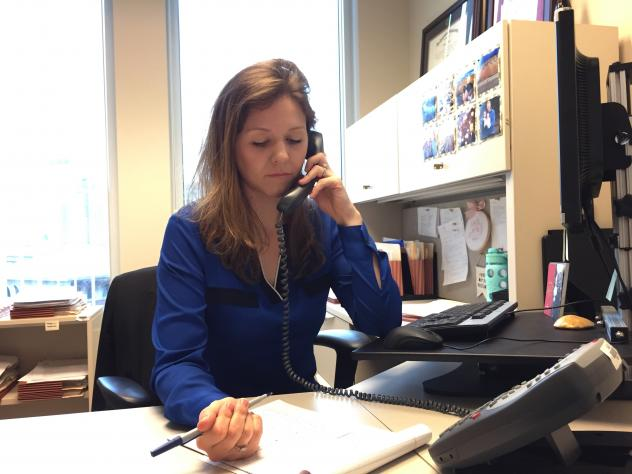 Assistant Attorney General Kimberly Strovink, of Massachusetts Attorney General Healey's Civil Rights Division, answers calls coming into the state's hate hotline.