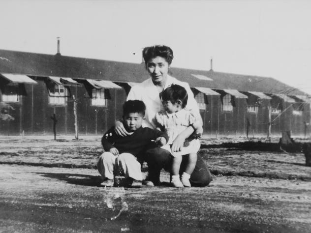 Members of the Japanese-American Mochida family await relocation to a camp in Hayward, Calif.