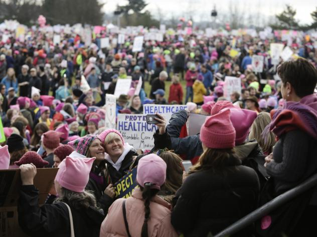 """Led by women in pink """"pussyhats,"""" hundreds of thousands of people packed the streets of Washington and other cities in a massive outpouring of opposition to America's new president, Donald Trump."""