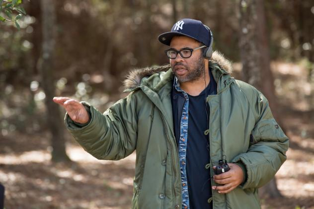 Writer, director, producer Jordan Peele directs a scene on the set of his new horror movie, <em>Get Out</em>.