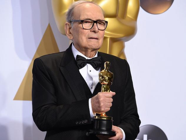 Composer Ennio Morricone, posing with his Oscar for <em>The Hateful Eight </em>in 2016. He died Monday at age 91 in Rome.