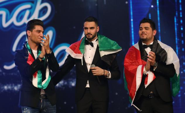 Palestinian Arab Idol TV show winners Yaacoub Shahin (center), Ammar Mohammed (left) and Amir Dandan stand on stage during the final in the pan-Arab song contest on Feb. 25, 2017 at MBC studios in Zouk Mosbeh, north of Beirut.