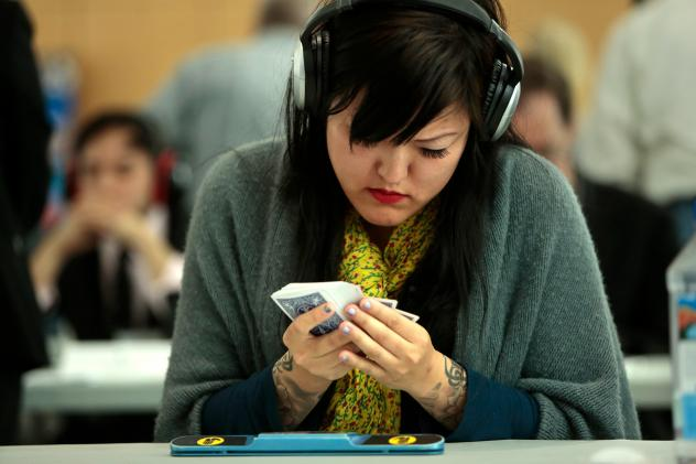 Memory athletes like Sue Jin Yang — competing here in the 17th annual USA Memory Championship, in New York City, in 2014 — wear headphones to block out distractions as they memorize the order of deck of cards.