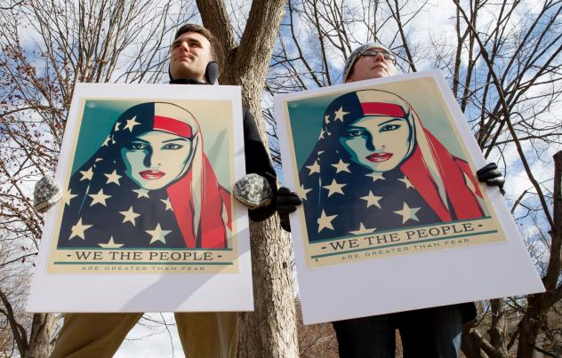 Demonstrators gathered near the White House on March 11 to protest President Trump's travel ban on six Muslim countries.