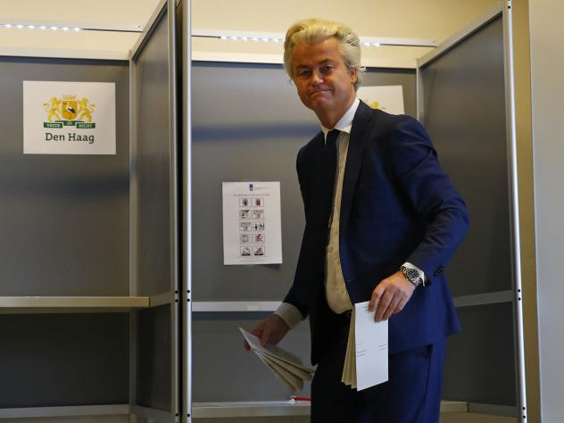 Geert Wilders speaks to the press on election night in The Hague, as returns showed the Liberal party of Dutch Prime Minister Mark Rutte set to win the most seats in the legislature.