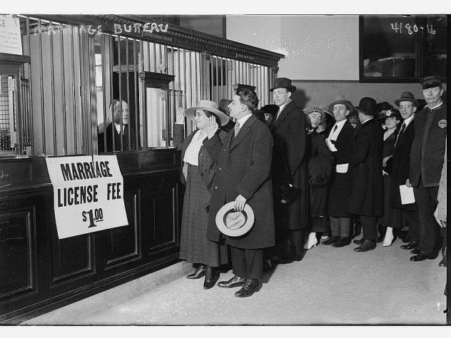 Couples stand in line to obtain their marriage licenses in this photograph, taken sometime between 1915 and 1920. The 1907 Expatriation Act would have affected people trying to get married during this time period — though the couples depicted in this p