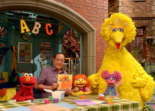 """Julia (center) first appeared online and in printed materials as a part of <em>Sesame Street</em>'s<a href=""""http://autism.sesamestreet.org/storybook-we-are-amazing/"""" target=""""_blank""""> See Amazing in all Children</a> initiative. She'll now appear on TV as"""
