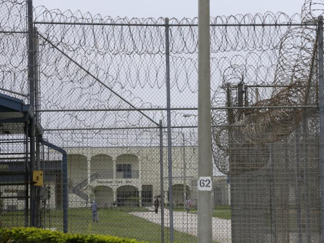 A prisoner works on the lawn at the Dade Correctional Institution In 2014, in Florida City, Fla. On Friday, Miami-Dade prosecutor Katherine Fernandez Rundle found no wrongdoing in the death of mentally ill prisoner Darren Rainey, who was locked in a show