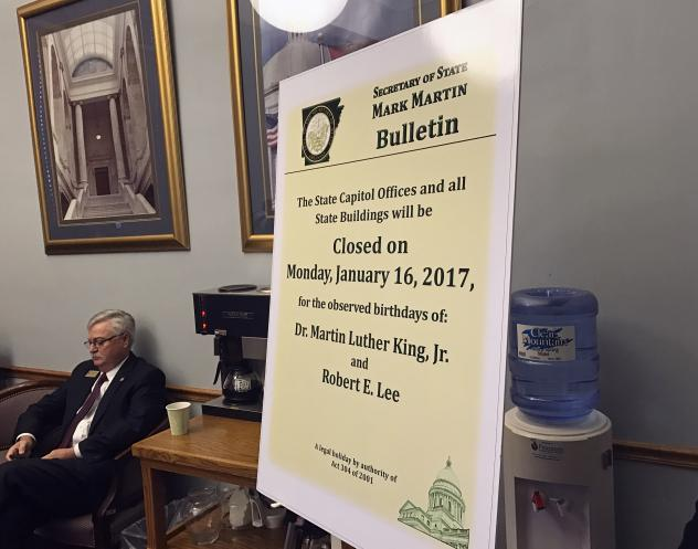 On of the notices posted marking the dual holiday honoring Confederate Gen. Robert E. Lee and slain civil rights leader Martin Luther King Jr., as posted at a Senate Education Committee hearing in Little Rock, Ark. Gov. Asa Hutchinson plans to sign into