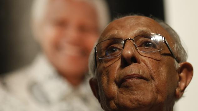"""Anti-apartheid activist Ahmed """"Kathy"""" Kathrada talks during a tribute to his close friend and former South African President Nelson Mandela at Gandhi Hall on Dec. 8, 2013, in Johannesburg. Kathrada died on Tuesday at 87."""