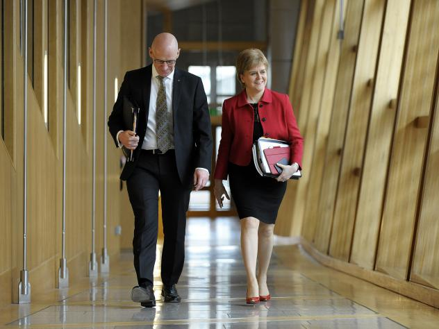 Scottish First Minister Nicola Sturgeon and Deputy First Minister John Swinney arrive at Scottish Parliament on Tuesday. They attended the second day of debate on a motion that ultimately granted Sturgeon the authority to pursue an independence referendu