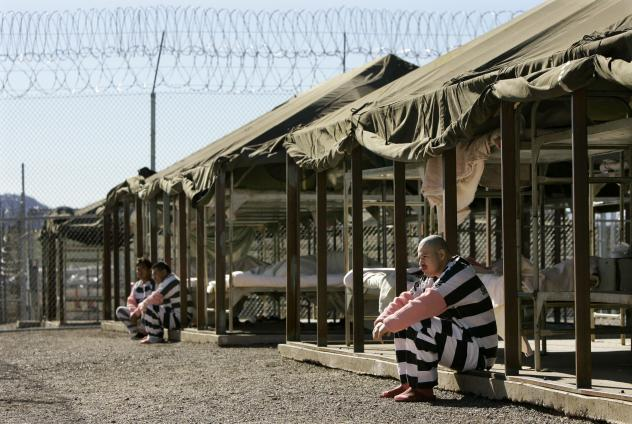 Inmates sit next to their bunks in the courtyard of the Tent City Jail in Arizona's Maricopa County.