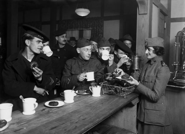 """GIs enjoy a cup of coffee during World War II. """"The American soldier became so closely identified with his coffee that G.I. Joe gave his name to the brew,"""" according to coffee historian Mark Pendergrast."""