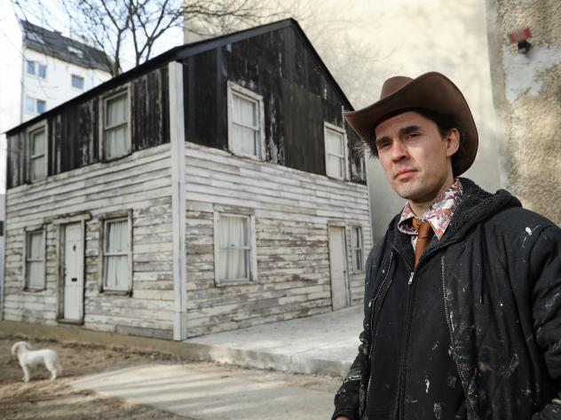 U.S. artist Ryan Mendoza poses for a photo next to the former house of Afro-American human rights figure Rosa Parks on Mendoza's property on April 6, 2017 in Berlin, Germany. Mendoza bought the house, which was slated for demolition in Detroit, took it a