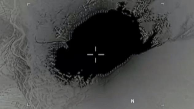 A GBU-43/B Massive Ordnance Air Blast bomb strikes ISIS-K cave and tunnel systems in Afghanistan's Nangarhar Province, in a screenshot from video released by the Pentagon.