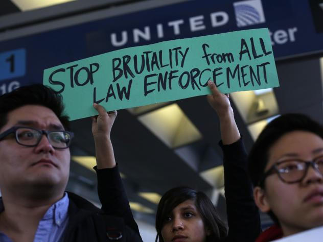 Demonstrators protest United Airlines at O'Hare International Airport on April 11, 2017 in Chicago, Illinois. The protest was in response to airport police officers physically removing passenger Dr. David Dao from his seat and dragging him off the airpla