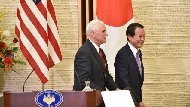 Vice President Pence and Japanese Deputy Prime Minister and Minister of Finance Taro Aso leave the prime minister's official residence in Tokyo on Tuesday. Pence said the U.S. and Japan had launched talks that could eventually result in a bilateral trade