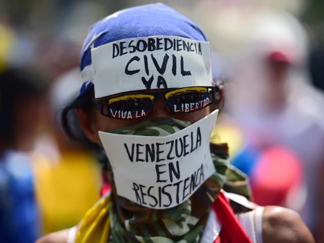 Demonstrators hurl flaming objects at riot police during the anti-Maduro rally in Caracas.