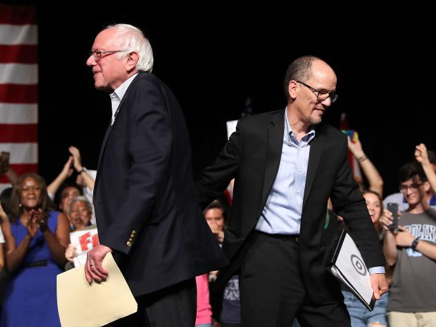 """People listen during an event that featured DNC Chair Tom Perez and Sen. Bernie Sanders during their """"Come Together and Fight Back"""" tour at the James L Knight Center on Wednesday in Miami, Fla."""