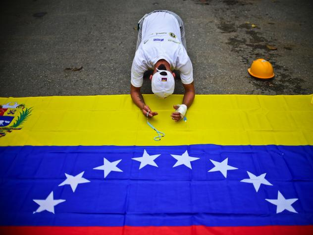 A Venezuelan student pays tribute Saturday to Juan Pablo Pernalete, a fellow student killed by a gas grenade during a protest last week against President Nicolas Maduro.