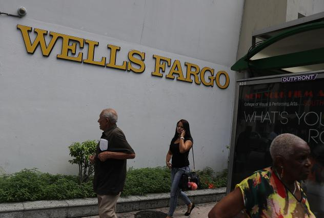 People walk in front of a Wells Fargo branch on Sept. 9, 2016 in Miami, Fla. On Monday, the U.S. Supreme Court ruled that the city of Miami can sue Wells Fargo and Bank of America under the Fair Housing Act for damages caused by allegedly predatory and d
