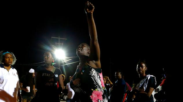 Veda Washington-Abusaleh attends a vigil Tuesday night for her nephew Alton Sterling, who was shot by police last July in Baton Rouge, La.
