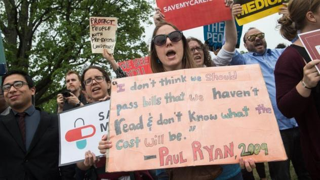 Protesters shout at lawmakers walking out of the Capitol on Thursday after the House of Representatives narrowly passed a Republican effort to repeal and replace the Affordable Care Act.