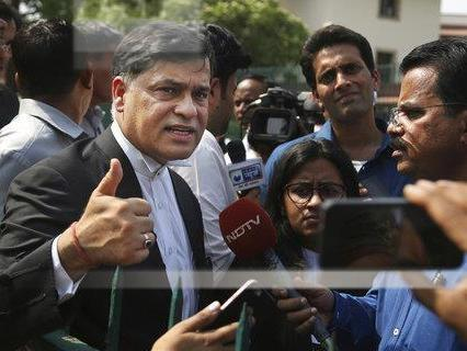 Siddhartha Luthra, a prosecutor in the fatal 2012 gang rape on a moving bus, gives a thumbs-up after the Supreme Court verdict Friday in New Delhi.