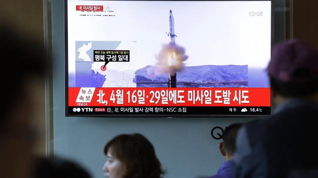 People watch a TV news program showing a file image of a previous missile launch conducted by North Korea at the Seoul Railway Station in Seoul. North Korea on Sunday test-launched a ballistic missile that landed in the Sea of Japan, the South Korean, Ja