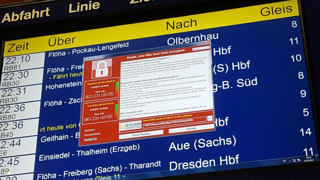 After the WannaCry cyberattack hit computer systems worldwide, Microsoft says governments should report software vulnerabilities instead of collecting them. Here, a ransom window announces the encryption of data on a transit display in eastern Germany on