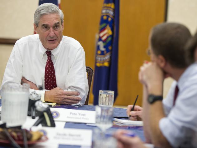 Robert Mueller speaks during an interview at FBI headquarters in Washington on Aug. 21, 2013, as his tenure as FBI director was coming to an end.