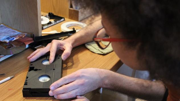 Michael Grant adjusts the settings on a Hi-8 deck at the event in Baltimore.