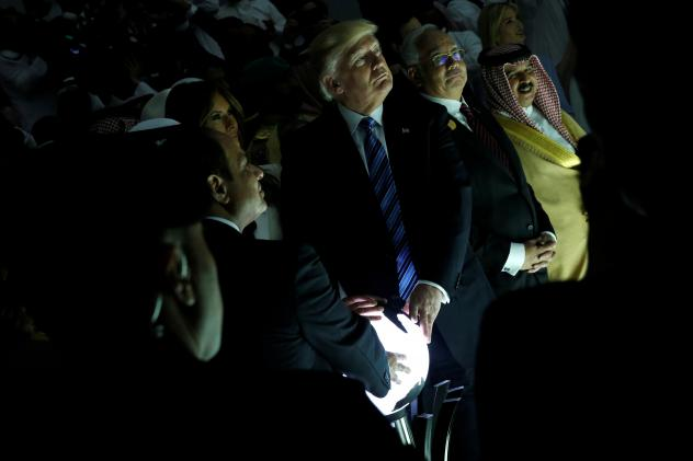 Together with Egyptian President Abdel-Fattah el-Sissi and Saudi King Salman bin Abdul-Aziz Al Saud, President Trump touches a lit-up globe that activated a video at the inauguration of the Global Center for Combating Extremist Ideology in Riyadh, Saudi