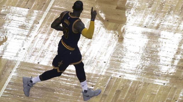 Cleveland Cavaliers forward LeBron James celebrates his three-point basket during the second half of Game 5 of the Eastern Conference finals against the Boston Celtics on Thursday in Boston. The points made James the NBA's all-time leading playoffs score