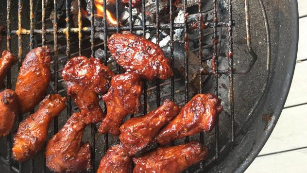 """Ribs """"mopped"""" with barbecue sauce on the grill. """"We're not painting a house; we're fixing a meal. That's why we use a mop"""" instead of a brush, Mike explains."""